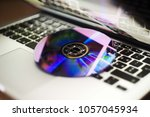 dvd disc isolated on computer... | Shutterstock . vector #1057045934
