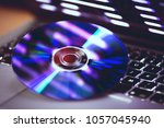 dvd disc isolated on computer... | Shutterstock . vector #1057045940