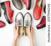 stylish female spring or autumn ... | Shutterstock . vector #1057046246