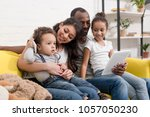 happy young family spending... | Shutterstock . vector #1057050230