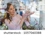 a beautiful woman's florist... | Shutterstock . vector #1057060388