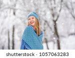 winter young woman portrait.... | Shutterstock . vector #1057063283