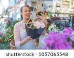 cheerful satisfied female... | Shutterstock . vector #1057065548