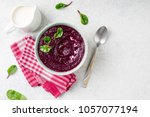 beetroot cream soup in bowl on... | Shutterstock . vector #1057077194