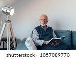 elderly man reading a book   Shutterstock . vector #1057089770