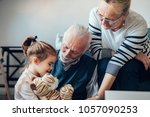 Stock photo grandparents playing with their granddaughter 1057090253