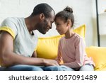 father and daughter looking at... | Shutterstock . vector #1057091489