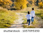 two brothers little stylish... | Shutterstock . vector #1057095350