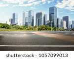 city road with cityscape and... | Shutterstock . vector #1057099013