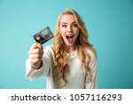 portrait of a cheerful young... | Shutterstock . vector #1057116293