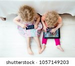 two young antisocial children... | Shutterstock . vector #1057149203