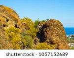 hill top with rocky surface on... | Shutterstock . vector #1057152689