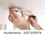 electrician. the electrician... | Shutterstock . vector #1057159076