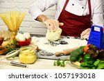 male hands work with kneaded...   Shutterstock . vector #1057193018