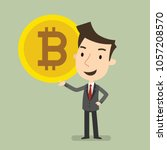 delighted to hold a bitcoin ... | Shutterstock .eps vector #1057208570