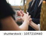 church tradition of exchanging... | Shutterstock . vector #1057210460