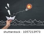 paper boat hanging on the light ... | Shutterstock . vector #1057213973