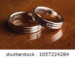 closeup of two golden rings on... | Shutterstock . vector #1057224284