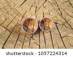 wedding rings on old dry wooden ... | Shutterstock . vector #1057224314