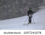 young boy skiing in a snow storm   Shutterstock . vector #1057241078