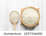 top view of rice in a wooden... | Shutterstock . vector #1057246400