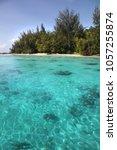 tropical coast of moorea with... | Shutterstock . vector #1057255874