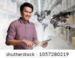 young asian businessman using... | Shutterstock . vector #1057280219