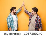 portrait of a two happy young... | Shutterstock . vector #1057280240
