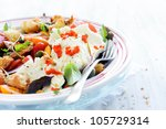 Fresh mozzarella cheese with mix salad, cherry tomatoes, peppers, basil and croutons - stock photo