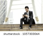young man with suit talking... | Shutterstock . vector #1057303064