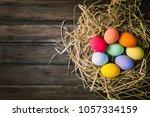 easter eggs in the nest on... | Shutterstock . vector #1057334159