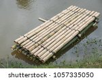 bamboo raft a way to travel by... | Shutterstock . vector #1057335050