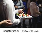 waiter carrying trays with food....   Shutterstock . vector #1057341263