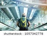 young traveler man in the... | Shutterstock . vector #1057342778