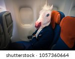 young funny man in comical mask ... | Shutterstock . vector #1057360664