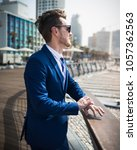 young man in elegant suit and... | Shutterstock . vector #1057362563