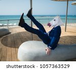young man in elegant suit falls ... | Shutterstock . vector #1057363529