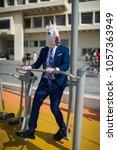 freaky man in elegant suit and... | Shutterstock . vector #1057363949