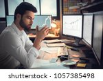 thoughtful serious trader... | Shutterstock . vector #1057385498