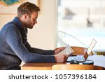 white man sitting at the dining ... | Shutterstock . vector #1057396184