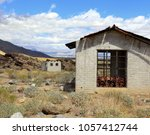 two old brick structures sit ...   Shutterstock . vector #1057412744