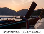 longtail boat at sunset against ... | Shutterstock . vector #1057413260