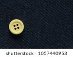 Clothes sewing button on a blue ...