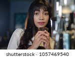portrait of young waitress... | Shutterstock . vector #1057469540
