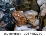 close up of pebbles in a stream ... | Shutterstock . vector #1057482230