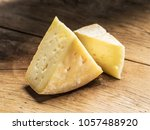 pieces of homemade cheese on... | Shutterstock . vector #1057488920