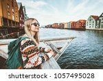 young blonde woman traveling in ... | Shutterstock . vector #1057495028