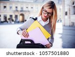 young businesswoman standing on ... | Shutterstock . vector #1057501880