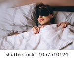 woman with sleeping mask | Shutterstock . vector #1057510124