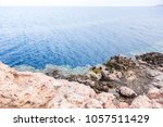the blue hole in dahab  egypt.... | Shutterstock . vector #1057511429